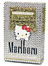 "Smoking Kitty Girl © 2016 // 3.5"" x 2.25"" x 1"" Mixed media * Marlboro box, Swarovski cut crystals, glitter, acrylic paint"